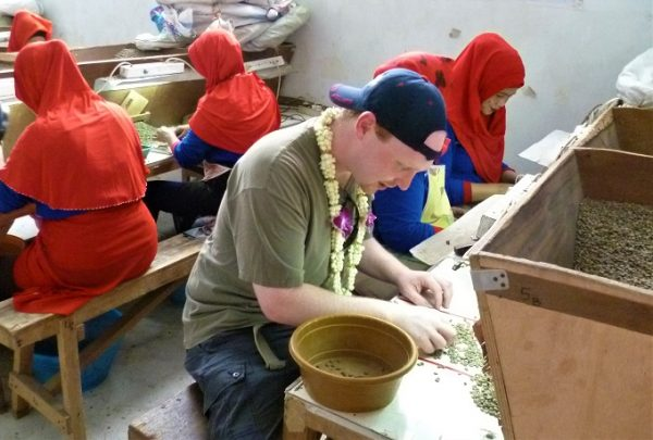 Jon helping with quality control at PT Indokom in Surabaya Java - The mill for the Bali Coffees