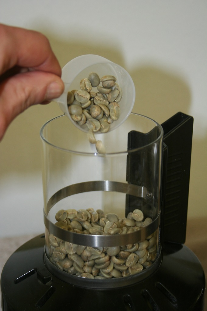 pour green coffee into roast chamber