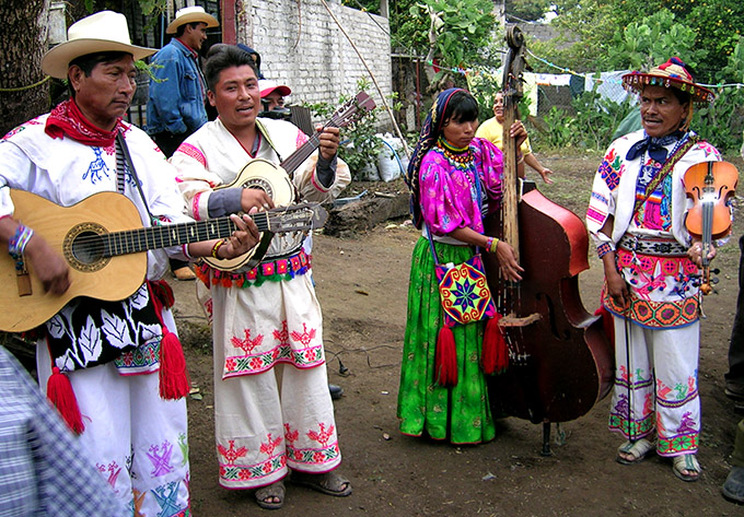 local musicians in brightly colored traditional garb