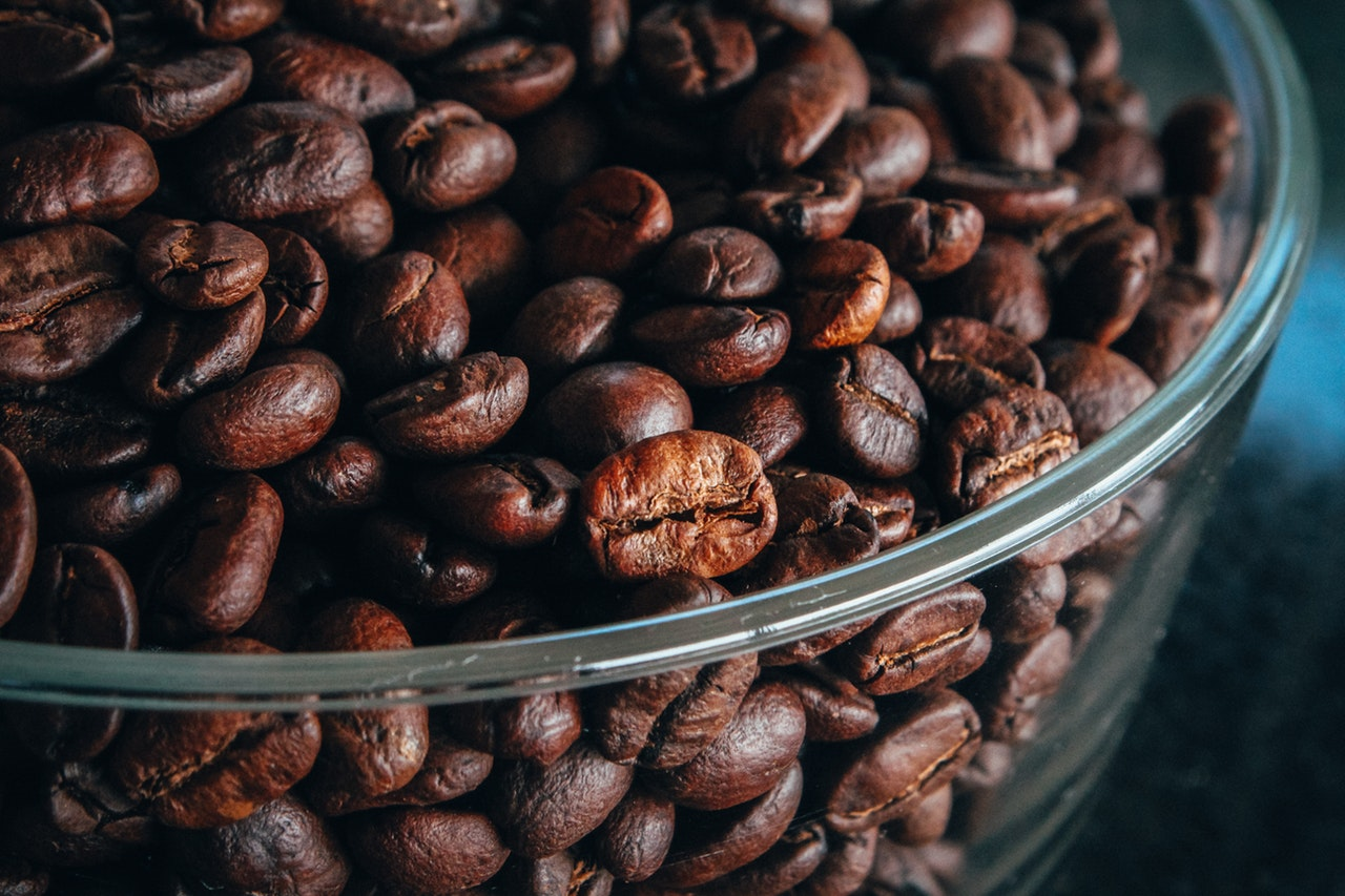 Bowl of roasted coffee beans